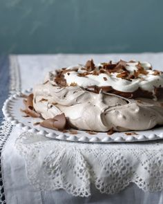 Chocolate Pavlova with Chocolate Cream and Whipped Cream.Cocoa and brown sugar lend this meringue a denser, moister, creamier texture than usual. Holiday Desserts, Just Desserts, Delicious Desserts, Dessert Recipes, Yummy Food, Trifle Desserts, Pastry Recipes, Chef Recipes, Summer Desserts
