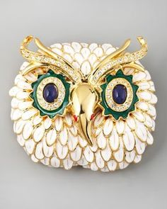 This is a wonderful owl pin, about 2 inches across, showcasing Kenneth Jay Lane's artistry with fine enamel.