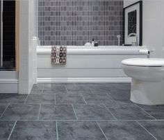 Grey bathroom floor tiles ideas can be browsed through the catalog or the magazines. Vinyl Flooring, Bathroom Flooring, Bathroom Vinyl, Bathroom Flooring Options, Amazing Bathrooms, Best Bathroom Tiles, Floor Tile Design, Grey Bathroom Floor, Bathroom Design