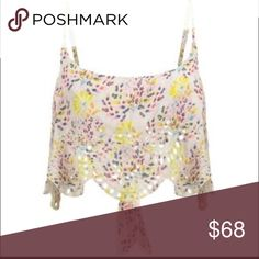 "Free People Crop Top Cami Medium Festival-ready crop top wizard floral print, embroidered eyelets and a scalloped hem.  Scoop neck, adjustable straps, back tie closure.  Length approx 16"". 100% Rayon.  Fits true to size Free People Tops Crop Tops"