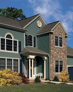 teal siding and stone! :)