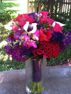 Bridesmaid bouquet featuring pinks and purples created by Lexington Floral in Shoreview, MN.    #flowers #bride #wedding