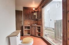 """Terrible real estate agent photos: """"Y'know, our new neighbours never wave back."""""""