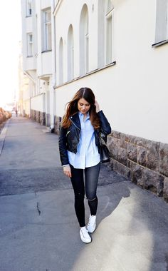 Casual spring style idea via Mariannan. Leather biker jacket, button down shirt, ripped jeans and sneakers.