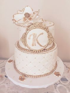 Elegant, vintage anniversery gold and White cake