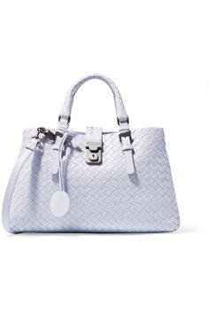 Bottega Veneta's classic 'Roma' tote is re-imagined in a fresh pale-lilac hue for spring. Hand-woven in Italy using the label's signature intrecciato technique, this supple leather piece is split into three compartments to help organize your belongings. Carry it by the top handles or attach the shoulder strap to keep hands free. #BottegaVeneta
