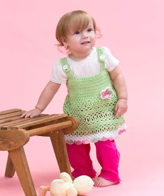 This sweet little crocheted sundress is  perfect every season! Layer it over a t-shirt  or turtleneck and wear tights or leggings  in cooler weather. New mommies will  appreciate that it can be easily wa
