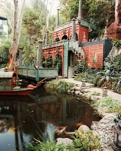 Eclectic Landscaping - A koi-filled pond surrounded by opulent Eastern-inspired architecture