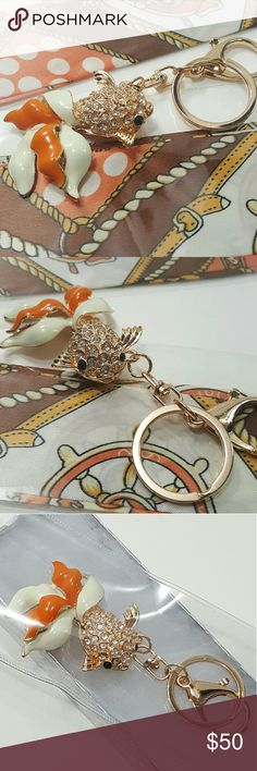 """Crystal Goldfish Keychain Charm w.Tangerine Twilly Goldfish Crystal Keychain Handbag Charm. Cute & Beautiful Keycharm Keychain Bag Charm Handbag Accessories wt matching ONE set of Tangerine Polka Dot Satin Twilly Size Charms: 4.5x2.0"""" Keycharm Color:White,Gold,Tangerine Twilly Size:39×1.5"""" Bundle any Keychain in my closet for EXTRA House Gift. Fast Shipping! Final Sale Item No return Prestige Condition. Bundle offer welcome! Be my VIP today, bookmark my 1st listing in my closet Carry…"""