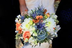 bouquet with succulents, dahlias, thistle, orchids, sweet peas, dusty miller