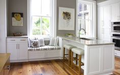 A feature on a warm inviting Kitchen, featuring Pottery Barn stools and products.