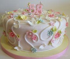 Swirls, flowers & butterflies - I love the light pastel colors looks dainty