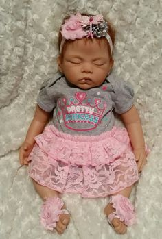 Cute Pretty Princess Onsie Newborn Size  Pink n Gray Headband with Pink Butterfly  Newborn Headband 13in  Newborn Barefoot Sandals  This would make a great Baby Shower Gift or a Photo Prop Outfit.  The Doll is a 20ins and is considered a Newborn Size