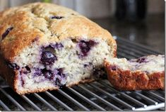 Blueberry Banana Bread! A healthy alternative to traditional breads made with oil, and includes Greek yogurt and bananas to create a delicious moist bread that you will not be able to stop eating!