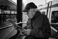 Man reading the paper sitting on the back seat of a tramway in Zurich. Street Pictures, Zurich, Reading, News, Reading Books