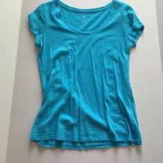 Light blue v-neck Adorable light blue v-neck tee. Barely worn. I loved the color but it is just too short for me. No rips, tears, or stains. New York & Company Tops Tees - Short Sleeve