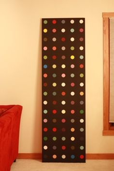 Neat project - door from Home Depot, paint, paint chips, and a circle punch.   Love all the colors.