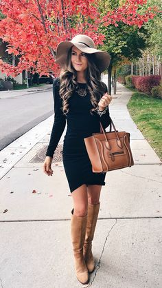 Long sleeved Black dress, tall Camel Brown boots, a structured purse, & a gorgeous natural floppy hat.