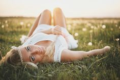 Beautiful young girl in dress on the spring meadow