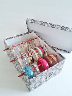 "Bangle Bracelet Storage box can be made from a shoe box & dowels, cover box with fabric or wrapping paper. Or get a pre-covered ""file box"" from Martha Stewart crafts. Can be stored in a drawer with lid or hung on a wall - I'm always looking for great organizer/storage ideas!"