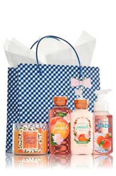 Georgia Peach & Sweet Tea - Ultimate Fragrance Fan - Bath & Body Works - Wrapped by you! Surprise her with an ultra pampering set of our Body Lotion (8 fl oz), Shower Gel (10 fl oz) and Gentle Foaming Hand Soap (8.75 fl oz), now bursting with our best foam ever! All this plus The Perfect 3-Wick Candle. Set and gift bag arrive unassembled for you to wrap & give with love!