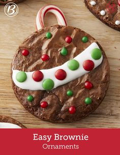 Easy-to-bake brownie ornaments make a fun holiday activity for the kids! Grab a few packages of cookie icing, holiday M&Ms, a handful of candy canes and festive sprinkles and make it a decorating party! To evenly cut candy canes for the picture-perfect ornament top, cut with scissors while still in the wrapper.