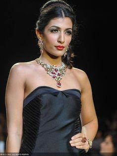 A model walks the ramp to showcase a design by jewellery designer D.Navinchadra during the India International Jewellery Week (IIJW), held at Grand Hyatt, Mumbai, on August 07, 2013.