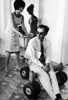 "Brigitte Bardot and Jean-Luc Godard on the set of ""Le Mépris"", 1963."