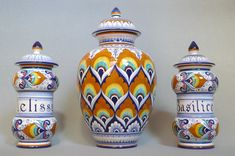 Lidded vase with and apothecary vases