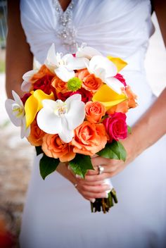 Tangerine and hot pink roses, yellow callas and bright white phalaenopsis orchids. #bouquet