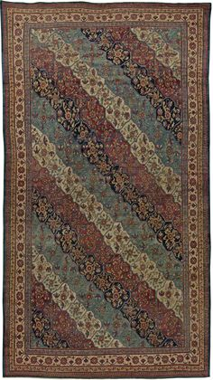 A late 19th century antique Persian Kirman (Kerman) rug, with an all over design of unusually Damask rose motif.
