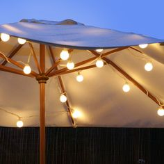 We will have large white garden parasols for the wedding.  Maybe we should light them up after dark?