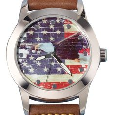 """American style. Men's classic style watch with brown leatherlike strap. The face of the watch has an American Flag design in red, white and blue with an eagle on top. · Band: 10"""" L x 7/8"""" W with Buckle closure · Actual face: 1 1/4"""" in diameter · Measurement of casing including lugs: 2 1/16"""" x 1 5/8"""" · Battery: Replaceable SR626SW · Movement: Quartz-PC21J · Imported"""
