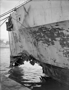 HMS Argonaut, showing the damage from the torpedo fired by Italian submarine, Mociengo, on 14/12/42. Repairs were to ensure that HMS Argonaut was out of action for the whole of 1943.