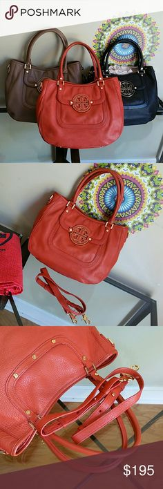 Tory Burch amanda orange hobo Great used condition...pic # 8 shows a very light color transfer Tory Burch Bags