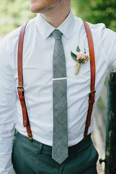 white shirt, a grey tie and brown leather suspenders