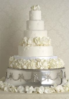 White Petal Cake.  The Confetti Blog: Confetti Cakes – Flower Petals to coordinate with your gorgeous Wedding Cake from www.confettidirect.com