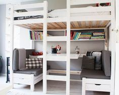 Bedroom: Under Bed As Hangout Area. loft bed with desk underneath. gray bench. wall shelving. white bed frame.
