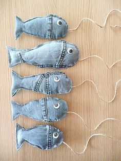fish made from denim jeans! cut simple fish shapes from old jeans, sew on eyes  if to be used by small children or hot glue wiggly eyes if  appropriate. attach cord/twine