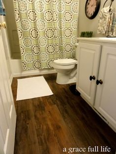 plank wood vinyl flooring! $50 for the whole room...sweet! plus i really like the look of the bathroom
