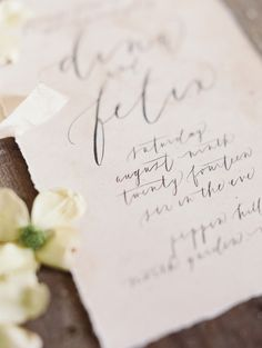 Dreamy wedding invitation on pale pink watercolor paper with graceful calligraphy by Oh My Deer. Image by Laura Gordon Photography.