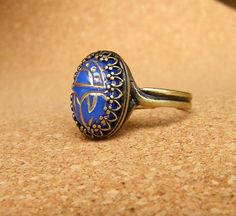 Vintage Style Scarab Ring. Gold leaf glass scarab brass ring. LOVE THIS.