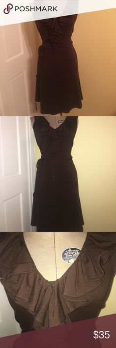 Ralph Lauren Petites Brown Sleeveless Ruffle Dress Chocolate Brown, sleeveless dress with a ruffled collar & string to wrap in front, back or side. Super stretchy. Form Fitting A classic Ralph Lauren Dress. Says Petites but fits any size.. Cotton/Modal Blend. Size P/M on label. Smoke Free Home. NWOT Lauren Ralph Lauren Dresses