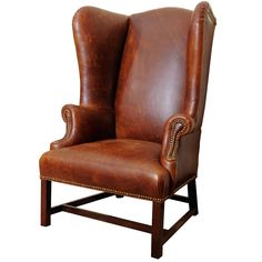 Georgian Style Wing Chair in Leather | From a unique collection of antique and modern wingback chairs at https://www.1stdibs.com/furniture/seating/wingback-chairs/
