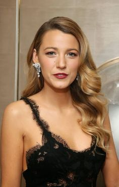 Blake Lively, winter blonde hair in Old Hollywood waves.