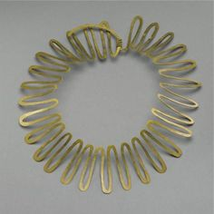 Alexander Calder, Untitled (Necklace), hammered brass, 13 1/4 by 11 by 2 in. 33.7 by 27.9 by 5.1 cm.       Executed circa 1938, this work is registered in the archives of the Calder Foundation