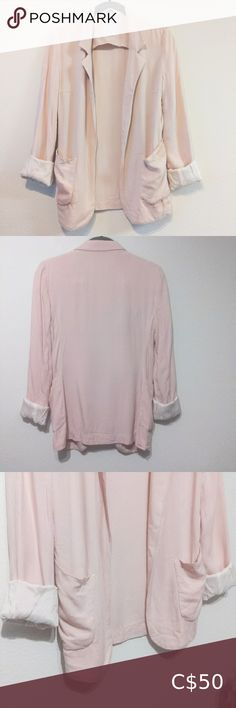 """🆕 Baby Pink Talula Kent Blazer Casual/business casual Open front style with generous pockets. Sleeves are lined with a luxurious barely-pink fabric with just the right amount of satin sheen to given it that extra little bit of glamourous oomph. Excellent, very lightly used condition. 9/10. Size 0, slightly oversized (might be more like a 2). Measurements (from Aritzia website); Bust: 32"""" Waist:24"""" Hips: 34"""" Fabric: Body: 100% Viscose Lining: 100% Cupro Rayon Doublure Always open to offers… Floral Blazer, Floral Jacket, Long Blazer, Casual Blazer, Suspender Skirt, Pink Fabric, Boho Tops, Business Casual, Jackets For Women"""