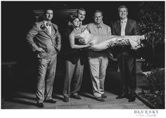 Charlotte wedding photographer bride being held by groomsman at #dukemansion  in Charlotte, NC Image by: www.cassbradleyweddings.com