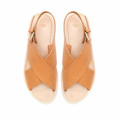 FLAT CROSSOVER SANDALS from Zara