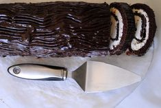 "On the eleventh day of Christmas my true love gave to me, a yule log? Can I eat it? One of the last Christmas foods we're honoring this season is the surprisingly French yule log. While a ""Yule Log"". Christmas Desserts, Christmas Treats, Christmas Baking, Holiday Treats, Holiday Recipes, Christmas Recipes, Christmas Cookies, Christmas Foods, Holiday Foods"